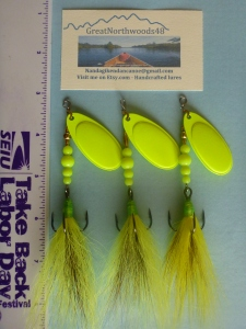 Our handcrafted spinners with chartreuse yellow tails and green finished heads. The #5 French Blades and VMC #2 Trebles make these excellent pike, bass...and even walleye attractors...depending on the season.