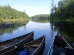 Boats in late afternoon; Petawawa R., Algonquin Park